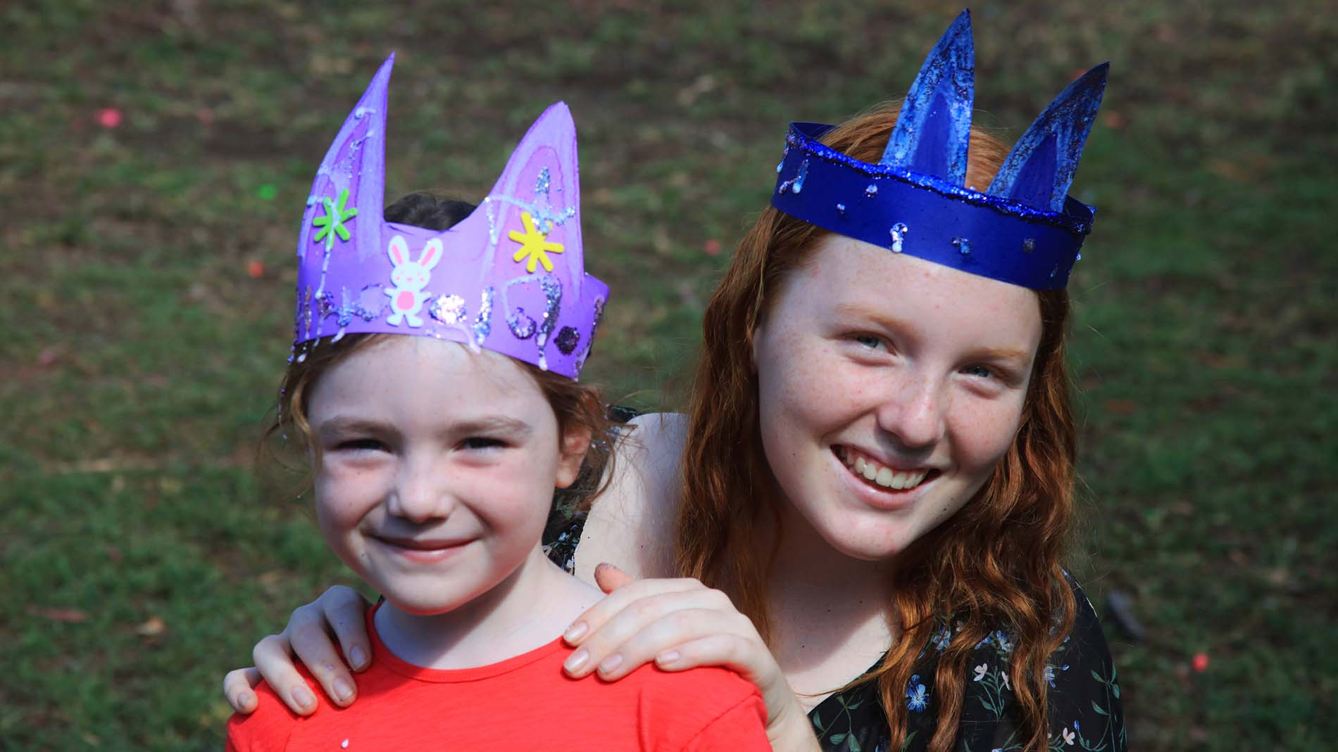 Two kids wearing their easter hats