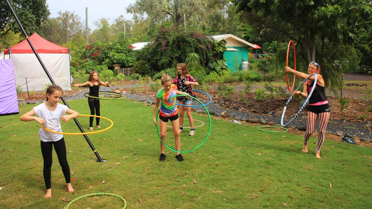 Group of young campers hula hooping