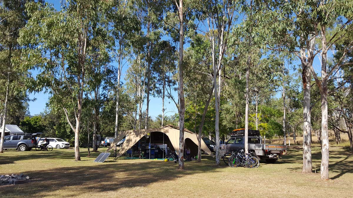 Large family tent set up under trees