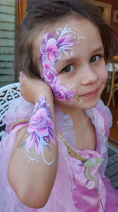 A young girl with face paint