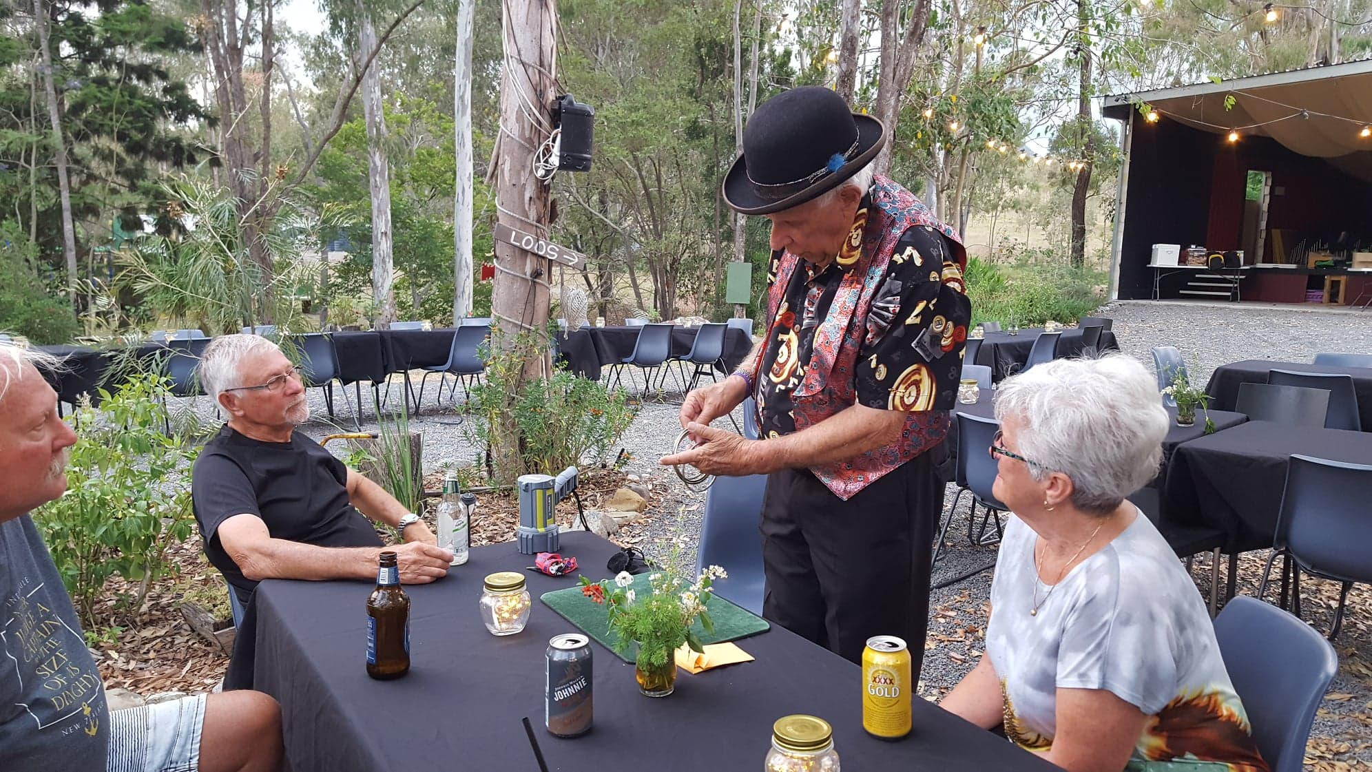 A magician doing tricks for the diners