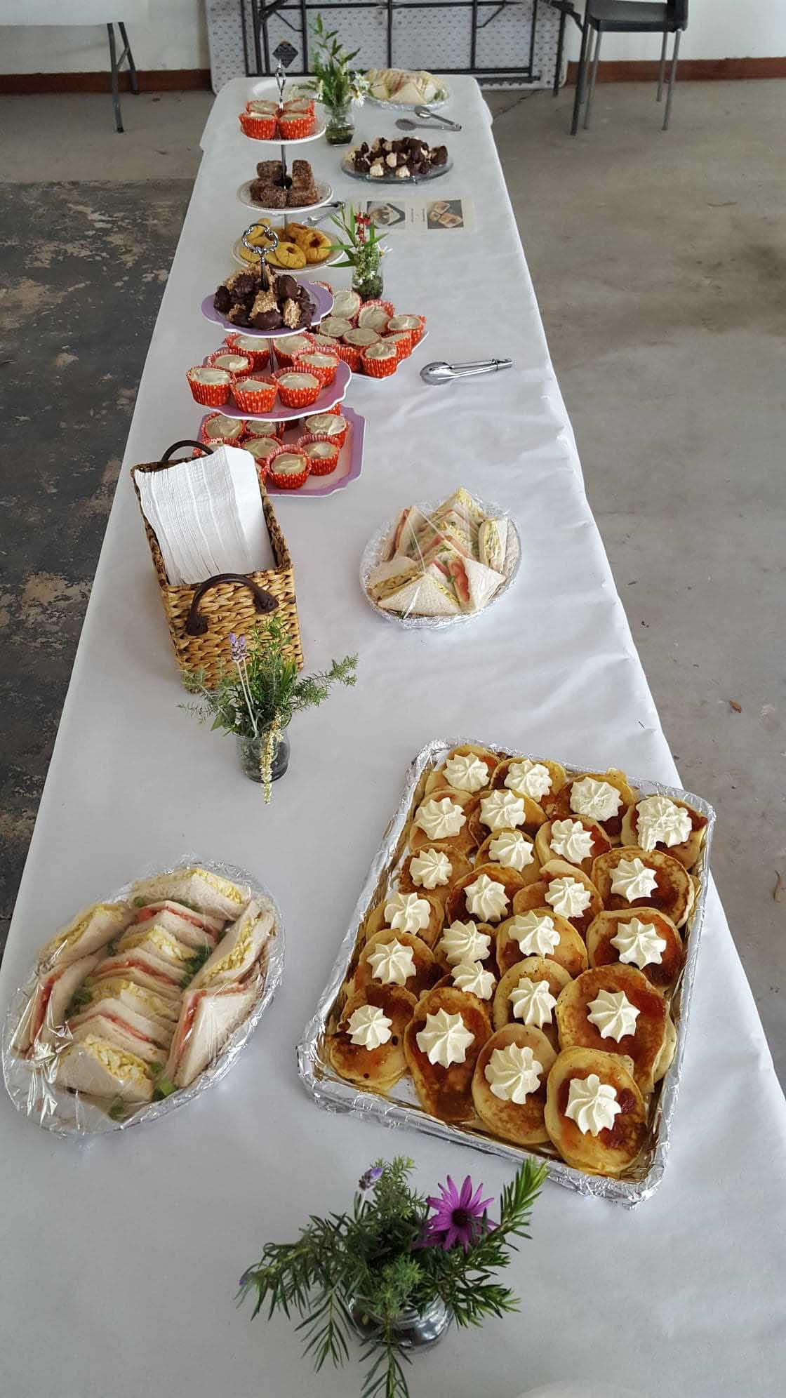 Morning tea displayed on a long table