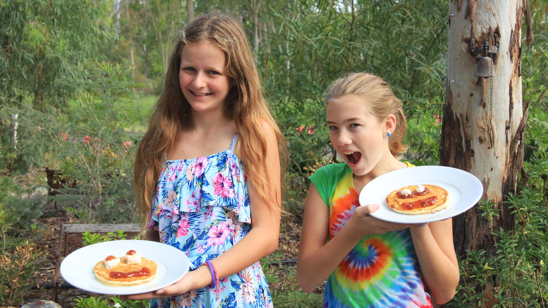 Two happy young campers with their pancakes