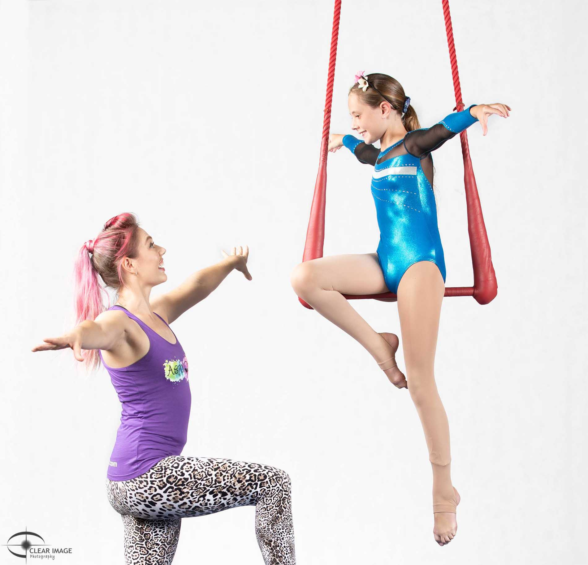 Teacher helping a student with aerials
